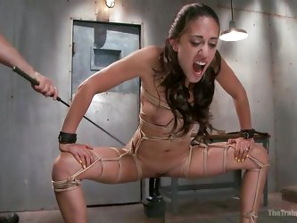 This sex master has taken Lyla Storm to the basement to show her pain and pleasure. She has a belt around her neck and rope wrapped around her arms an