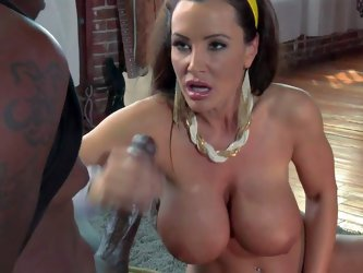 Lisa Ann is a hot bodied MILF with amazing gigantic boobs. She takes care of big sized black dick in this scene. She gets her giant melons fucked and