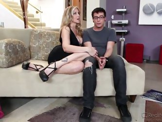 Attractive turned on blonde milf Julia Ann with massive hooters is hungry for young meat. Luckily for her she seduces young nerdy dude Dane Cross and