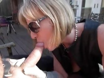 Sexy leather milf sucks and fucks outdoors