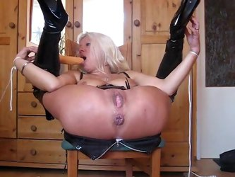 A video with a german couple who loves bondange. While the wife is tied up on a chair, her husband drills her buns with a dildo in a really hard manne