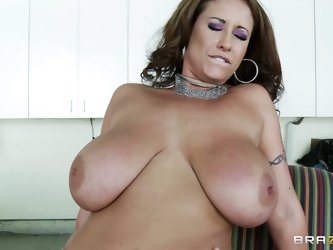 Eva Notty is a horny mom with enormous tits. She satisfies her sexual needs with hot guy in a messy room. She takes big prick between her jugs and the