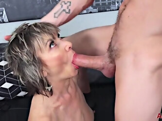 Lillian Tesh is fucking a much younger guy on the sofa and enjoying it a lot
