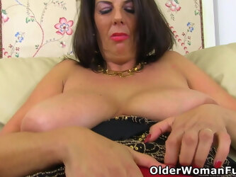 Classy mature Lulu plays with big tits and fanny