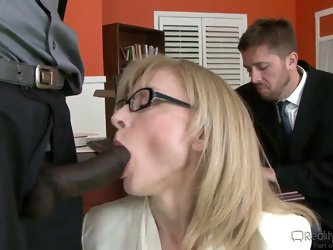 Bespectacled mature lady Nina Hartley in sexy stockings lifts up her skirt and gets her bush tongue fucked by black dude in front of her hubby. She  g