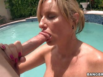 Jodi West is s good looking blond MILF who is proud of her killer body. She displays her huge melons and round ass in the pool before giving mouth job