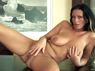 Fascinating milf Pandora with long legs and big natural boobs poses naked and then gives pleasure to herself. Busty mom loves posing with her legs apa