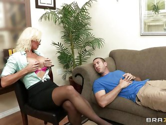 While working in the office he says he has desired for big tits, blonde busty milf helps him fulfilling his desire shows off her big nice breasts. Ask