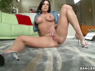 Attractive experienced brunette milf Kendra Lust with firm tits and big juicy ass in stripper shoes stretches her shaved wet fish lips while teasing h