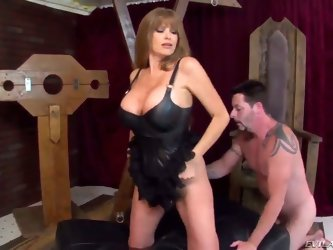 This wild blonde milf Darla Crane is one hot piece of ass, letting her huge tits show in a leather corset as she's on all fours with Jack Vegas l