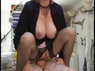 Mature boss and her employee having sex at work