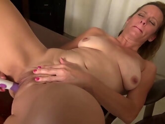 Mature blonde lady is masturbating while alone at home, and enjoying every single second of it