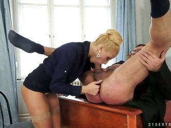 Blonde woman Chary Kiss is having fun with her fat boss. She lowers pants of male and starts sucking his cock very well pushing fingers into asshole o