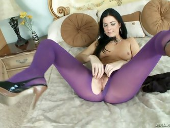 This one is for all you spandex lovers! India Summer is looking hotter than ever spreading her legs on the bed wearing a pair of purple spandex with a