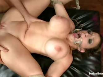Curvy milf Sara Jay with big hooters and shaved pussy gets tied up before master fucks her juicy hole like crazy. He bangs helpless big titted mature