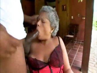 Granny in satin lingerie sucks big black cock