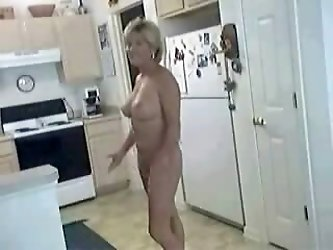Mature hot mature naked in kitchen showing off nice tits and pussy