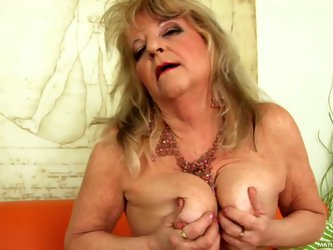 Naughty granny Lotta takes off her lingerie in front of the camera with no shame. She bares her tits and pussy. Just take a look at her aged snatch an