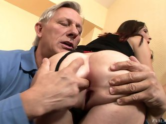 Long legged brunette Kattie Gold in black stockings turns aged man on. She grabs her ass cheeks and sticks two fingers in her asshole. Then he licks h