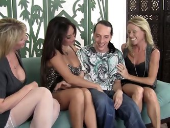 There are three dick hungry MILFs Nikki Charm, Claudia Valentine and Olivia Parrish. They are curious about cock sucking. Scott Lyons pulls out his pi