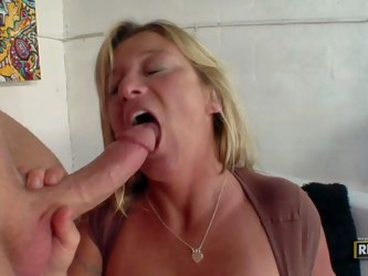 Sex starved mature blonde Samantha Lee with huge breasts has sex with hot young guy. She loves his rock hard cock and takes it in her hot mouth.