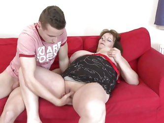 She stays with her thighs spread wide and receives a deep pussy fingering from this much younger guy. His fingers in her vagina makes the bbw hornier