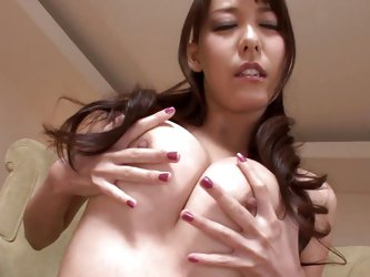 Horny Akari plays with her sexy breasts and squeezes them hard wishing for a cock between her boobs and lips. She then plays with her cunt and grabs a