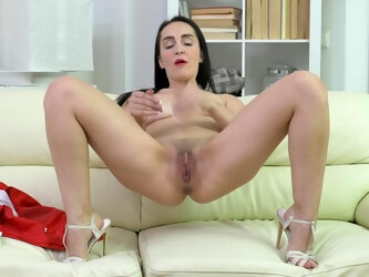 Small tits mature Di Devi opens her long legs to finger her cunt