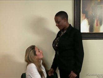 Sincerre Lemmore is a black mature lesbian with short hair and huge tits she hides under her blouse. She has a crash on Elexis Monroe  and seduces hot