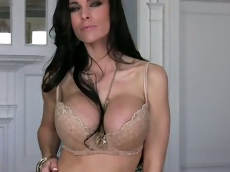 Busty MILF Laura Lee is looking superfine in that hot lingerie and she looks even hotter as she gets rid of it and starts working on that tight snatch