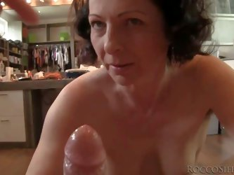 This video features Rocco Siffredi getting sucked off by slutty aged woman. Mature brunette with hairy snatch and natural tits strips down to her bare