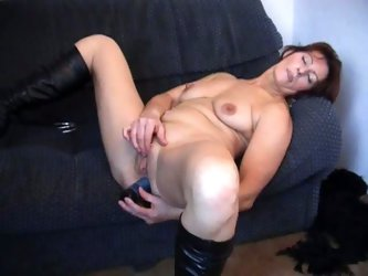 Naked mature woman Lazlo in boots has blue dildo to get anal pleasure. Hot aged woman with pierced cunt takes blue dildo in her asshole. She has anal
