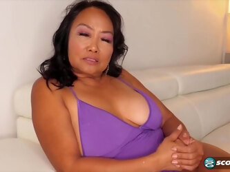 Mandy Thai is a voluptuous, mature brunette who likes to get cum all over her face