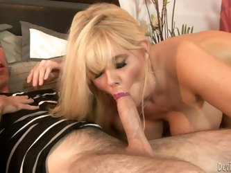 Long haired sexy blonde milf Karen Fisher strips naked before she gives blowjob to her step-son in the bedroom. Well-endowed woman sucks him like craz