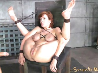Are you fond of kinky scenes of creative rope bondage? Click to see a slutty brown-haired milf with big tits restrained. Her arms and legs are tied up