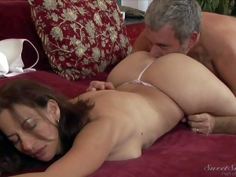 Naturally buxom milf Melissa Monet with juicy ass gets on her back and opens her legs after losing her g-string. She gets her trimmed snatch hungrily