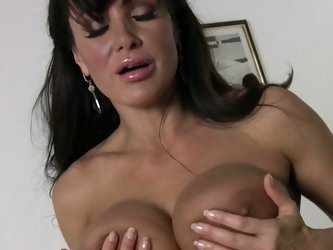 Black haired big boobed housewife Lisa Ann bares her assets after cleaning the house. Hot bodied milf exposes her big bare boobs and her bush in the m