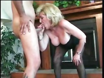 Older mature blonde lady is sucking a fucking a younger cock