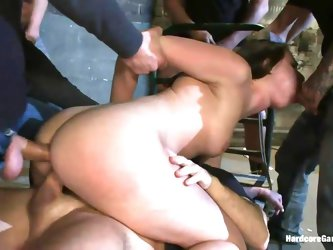 Here we have this sexy ass chick that has been bent over and subjugated by a bunch of guys that want to use her body merciless! They stick their cocks