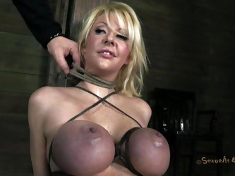 With her big boobs tied so hard that they've almost turned blue, Courtney awaits on the floor for her executor's attention. She doesn't
