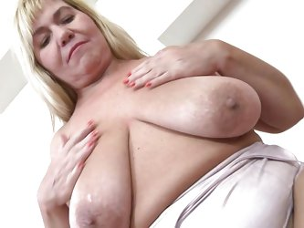 Kirsi takes off her top and shows you her very saggy tits. She lifts them up to her mouth and licks her puffy nipples for you. Watch as she spreads he