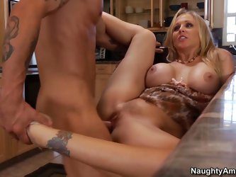 Ms. Julia Ann is as slutty woman that satisfies her sexual desires with her son's friend. She seduces him with her big jugs and opens her sexy lo