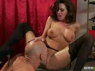 Dark haired milf Veronica Avluv is a pinup model that loves hardcore sex. She gets her snatch eaten and then takes bald guy's big hard dick in he