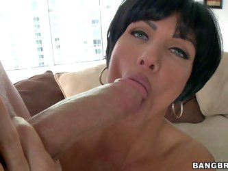 Shay Fox is a mouth-watering milf with big tits. Raven haired gorgeous woman with nice jugs gets naked and parts her legs before giving great blowjob