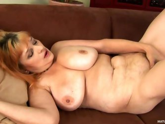 Aged lady Gunda can't wait to get her masturbation session started and takes off her red panties. She exposes her big natural mature tits and str