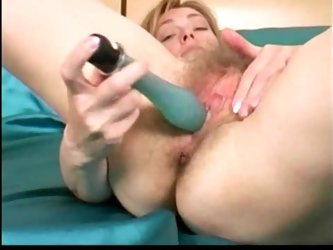 Hairy mature slut with a toy for her snatch