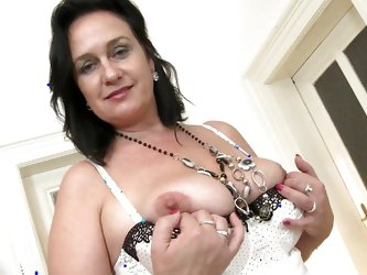 This dark haired mature slut loves to show off her natural breasts. She leans in and shows off her natural boobs. When she juggles her tits, it's