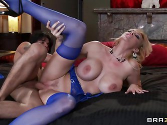 Hot blonde milf Charley Chase with big round breasts, sexy long legs, big cunt and long hair gets fucked sideways by a big hard cock. He spreads her l
