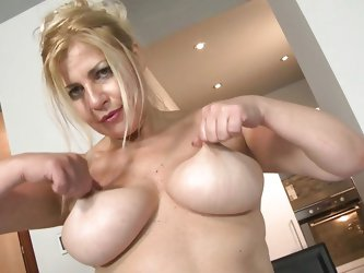 Evalina is a mature bitch with unsatisfied desires. She decides to take care of herself, so she got naked and starts rubbing her big breasts. She gets