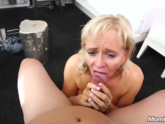 Mature blonde woman is making porn videos while alone at home, because it excites her a lot